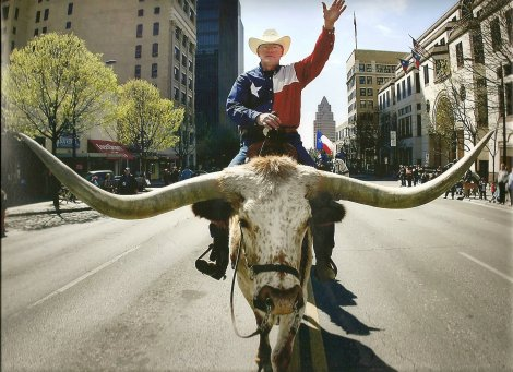 Pastor Barry Chinnon riding a longhorn.